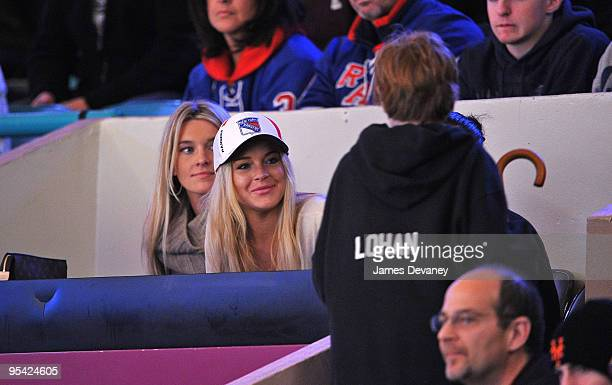 Lindsay Lohan and Dakota Lohan attend the New York Islanders vs New York Rangers game at Madison Square Garden on December 26 2009 in New York City