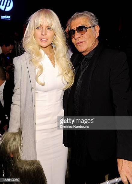 Lindsay Lohan and designer Roberto Cavalli attend the amfAR New York Gala To Kick Off Fall 2012 Fashion Week Presented By Hublot at Cipriani Wall...