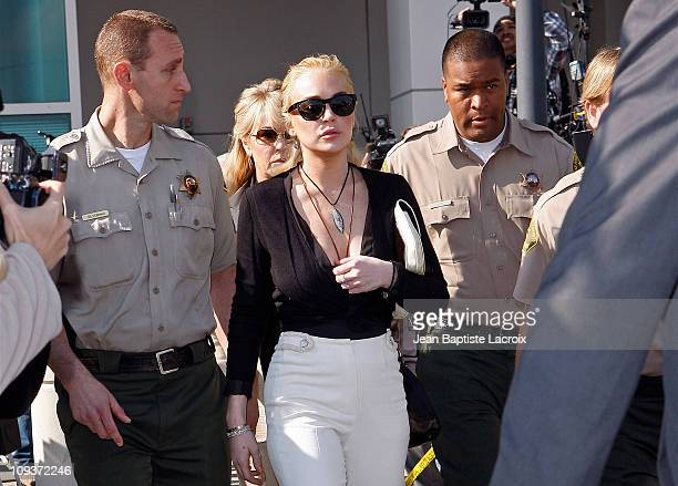 Lindsay Lohan and Dina Lohan are seen leaving the Airport Courthouse after a preliminary hearing on February 23, 2011 in Los Angeles, California.
