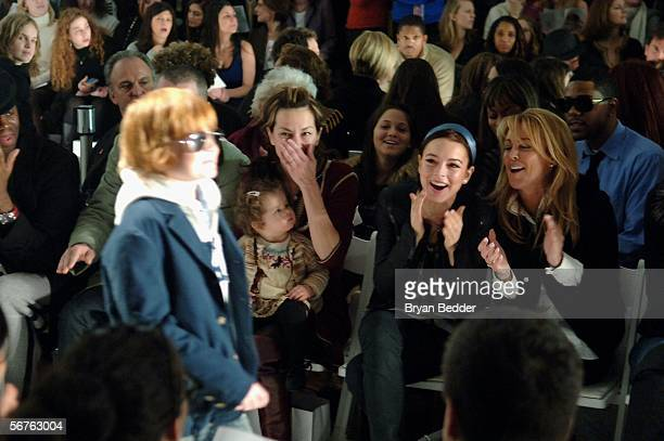 Lindsay Lohan and her mother Dina Lohan react as Dakota Lohan walks the runway at the Child Magazine Fall 2006 fashion show at Bryant Park during...