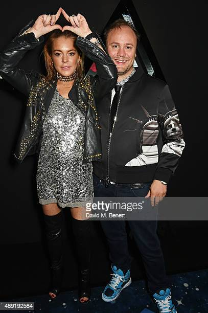 Lindsay Lohan and Nicholas Kirkwood attend Nicholas Kirkwood 10 year collection Launch and Party during London Fashion Week on September 19 2015 in...