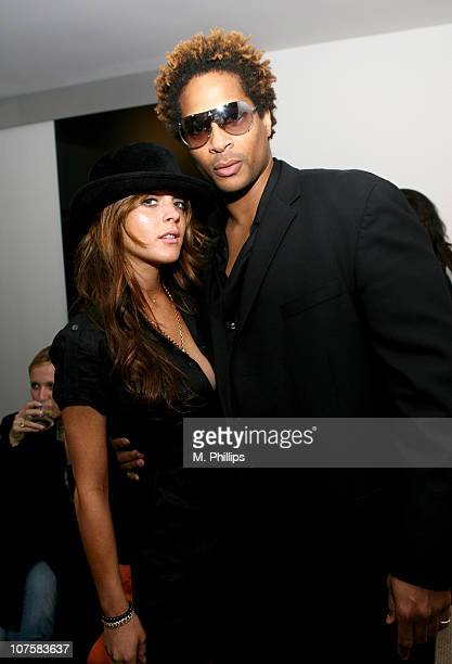 Lindsay Lohan and St. John during GQ / Calvin Klein Celebrity Poker Tournament Benefiting Peace Games - Calvin Klein Gift Lounge at Private Residence...