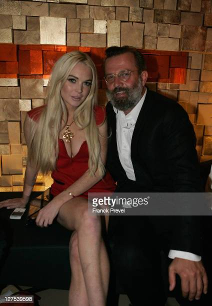 Lindsay Lohan and stylist Robert Rabensteiner attend the Gareth Pugh Aftershow Party during Ready to Wear Spring / Summer 2012 Paris Fashion Week at...