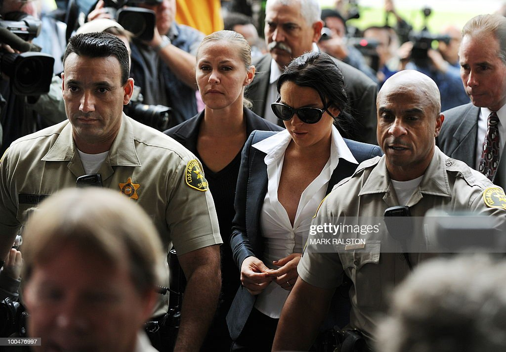 Lindsay Lohan (2nd R) arrives for a hearing to respond to allegations she has not completed a set number of alcohol education classes, at the Beverly Hills Courthouse on May 24, 2010. Lindsay Lohan who failed to appear for a court hearing in Los Angeles last week, prompted a judge to issue an arrest warrant that was later withdrawn when lawyers for the troubled actress posted bail. Lohan, 23, had been ordered to appear before Judge Marsha Revel to respond to allegations she has not completed a set number of alcohol education classes required under the terms of her probation. AFP PHOTO/Mark RALSTON