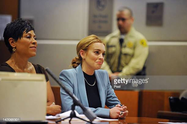 Lindsay Lohan attends her probation hearing with attorney Shawn Chapman Holley at the Airport Courthouse on March 29, 2012 in Los Angeles,...