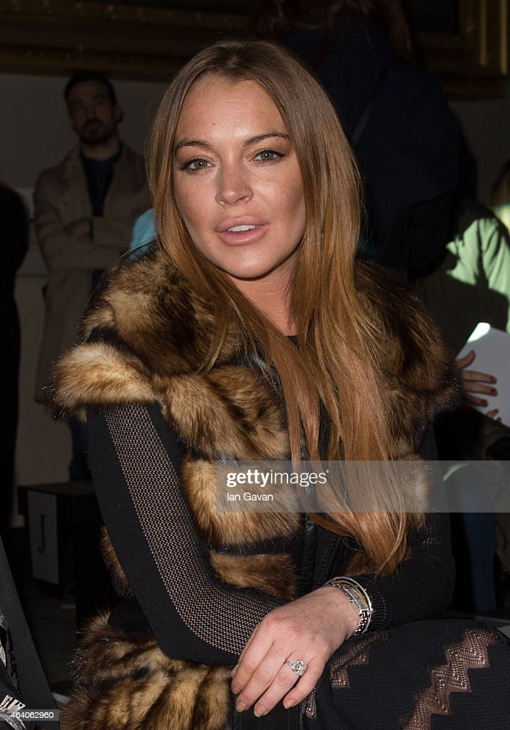 Lindsay Lohan attends the Gareth Pugh show during London Fashion Week Fall/Winter 2015/16 at Victoria & Albert Museum on February 21, 2015 in London, England.