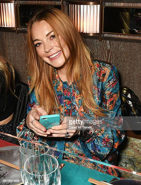 Lindsay Lohan attends the launch of Sexy Fish London in Berkeley Square on October 8 2015 in London England