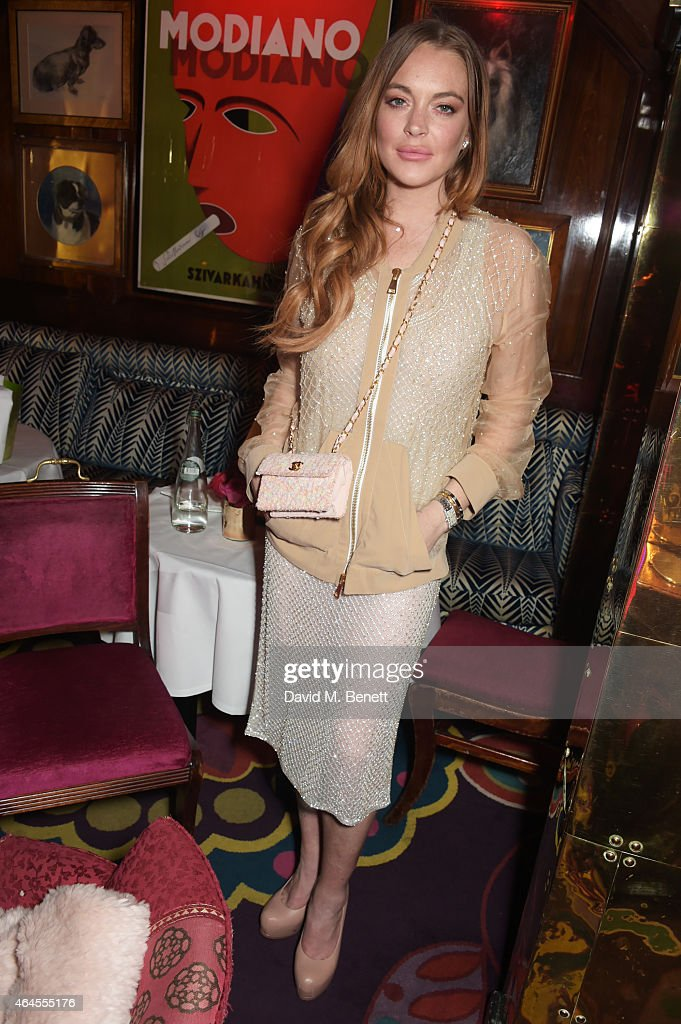 Lindsay Lohan attends the Mert & Marcus House of Love party for Madonna at Annabel's on February 26, 2015 in London, England.