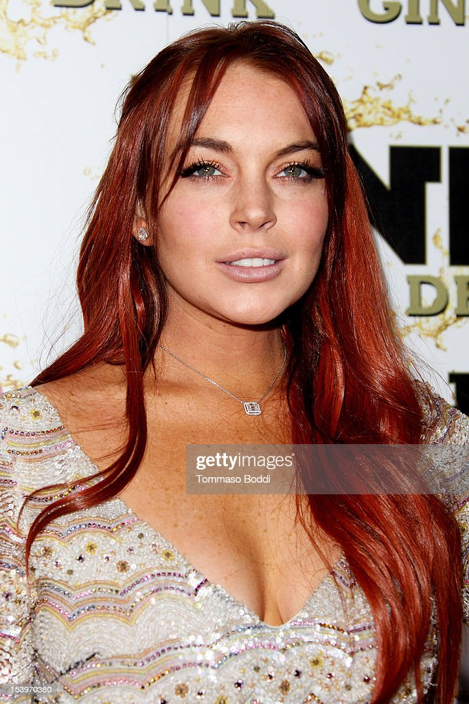 Lindsay Lohan attends the Mr. Pink ginseng drink launch party held at the Regent Beverly Wilshire Hotel on October 11, 2012 in Beverly Hills, California.