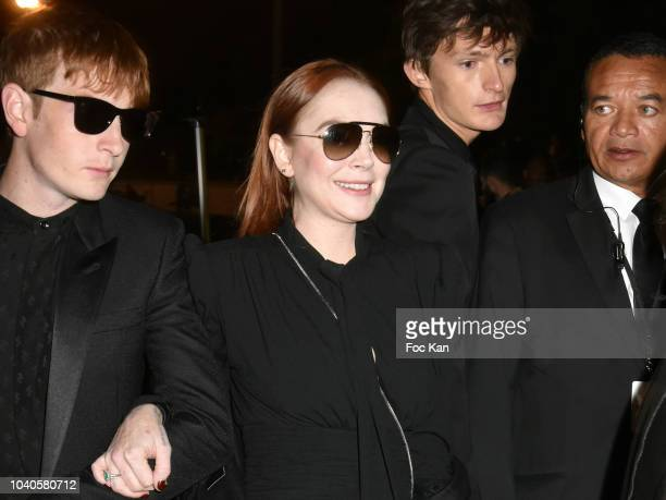 Lindsay Lohan attends the Saint Laurent show as part of Paris Fashion Week Womenswear Spring/Summer 2019 on September 25, 2018 in Paris, France.