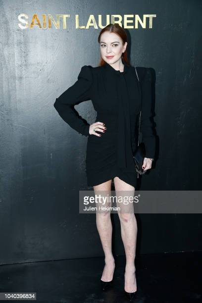 Lindsay Lohan attends the Saint Laurent show as part of the Paris Fashion Week Womenswear Spring/Summer 2019 on September 25 2018 in Paris France