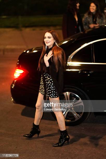 Lindsay Lohan attends the Saint Laurent show, during Paris Fashion Week Womenswear Fall/Winter 2019/2020, on February 26, 2019 in Paris, France.