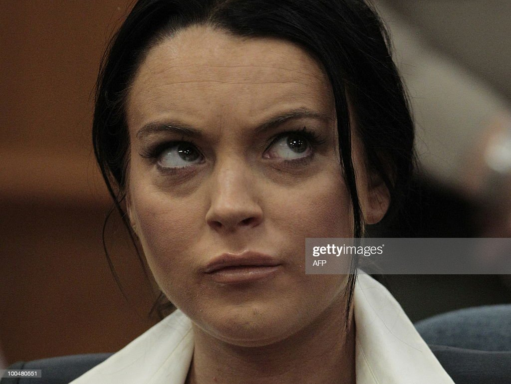 Lindsay Lohan during a hearing to respond to allegations she has not completed a set number of alcohol education classes, at the Beverly Hills Courthouse on May 24, 2010. Lindsay Lohan who failed to appear for a court hearing in Los Angeles last week, prompted a judge to issue an arrest warrant that was later withdrawn when lawyers for the troubled actress posted bail. Lohan, 23, had been ordered to appear before Judge Marsha Revel to respond to allegations she has not completed a set number of alcohol education classes required under the terms of her probation. AFP PHOTO/POOL/Jae C. HONG