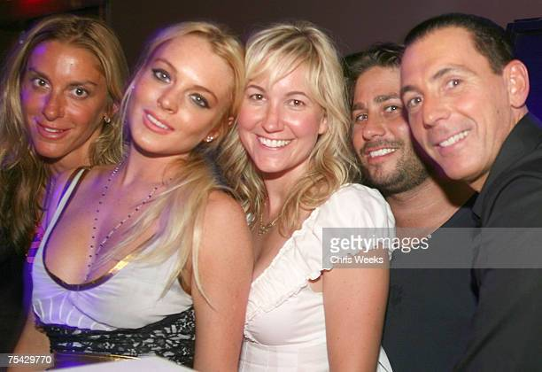 LAS VEGAS JULY 13 Lindsay Lohan entertainment attorney Mike Heller Steve Davidovici and unidentified guests attend Saturday Evening at PURE Nightclub...