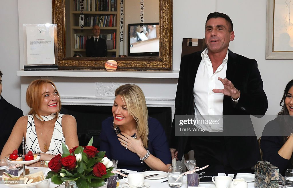 Lindsay Lohan, Hofit Golan and Alessandro Grassini-Grimaldi attend an afternoon tea hosted by Damiani in aid of Nadedza Foundation at Morton's Club on November 9, 2016 in London, England.
