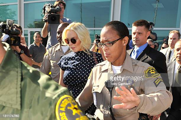 Lindsay Lohan leaves her probation violation hearing at the Airport Courthouse on November 2 2011 in Los Angeles California Lohan was sentenced to...