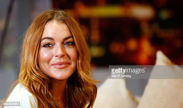 Lindsay Lohan performs during a photocall for Speed The Plow at Playhouse Theatre on September 30 2014 in London England
