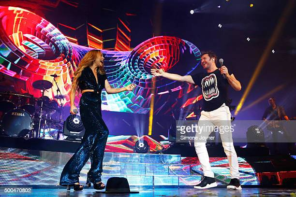 Lindsay Lohan performs on stage with Simon Le Bon of Duran Duran at The O2 Arena on December 8 2015 in London England