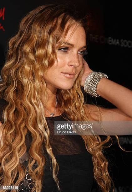 Lindsay Lohan poses at a screening of Filth and Wisdom hosted by The Cinema Society and Dolce and Gabbana at the Sunshine IFC Center on October 13...