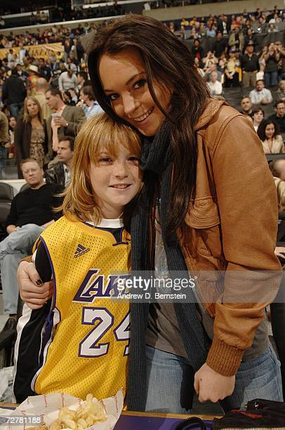 Lindsay Lohan poses with brother Cody during haltime of the Los Angeles Lakers versus the Atlanta Hawks on December 8 2006 at Staples Center in Los...