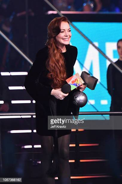 Lindsay Lohan presents the award for Best Electronic Artist on stage during the MTV EMAs 2018 on November 4 2018 in Bilbao Spain