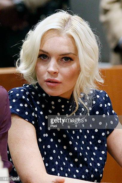 Lindsay Lohan sits in court during her probation violation hearing at the Airport Courthouse on November 2 2011 in Los Angeles California Lohan was...