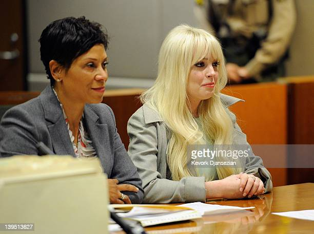 Lindsay Lohan sits in court for her probation update hearing with attorney Shawn Chapman Holley at the Airport Courthouse on February 22, 2012 in Los...