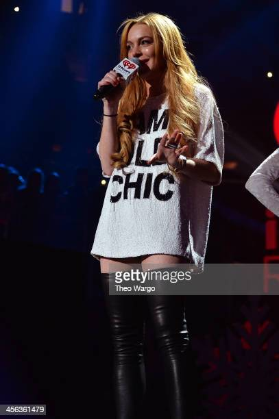 Lindsay Lohan speaks onstage during Z100's Jingle Ball 2013 presented by Aeropostale at Madison Square Garden on December 13 2013 in New York City