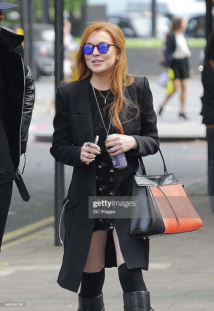 Lindsay Lohan strolls through Mayfair before heading to The Dorchester Hotel on June 2, 2014 in London, England.