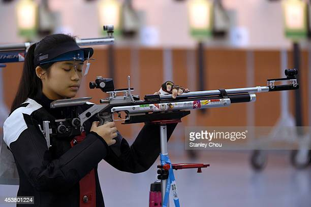 Lindsay Martina Veloso of Singapore prepares to shoot during Day 3 of the 2014 Summer Youth Olympic Games of the Girls 10m Air Rifle Final at the...