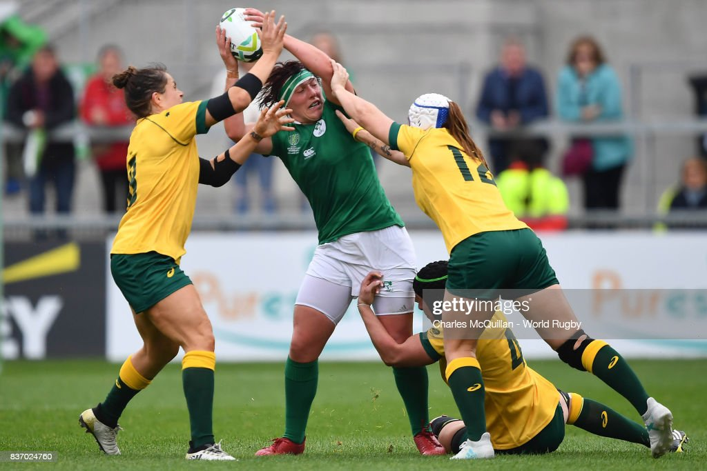 Lindsay Peat of Ireland and Shami Williams and Mahalia Murphy of Australia during the Womens Rugby World Cup 5th place semi-final at the Kingspan Stadium on August 22, 2017 in Belfast, United Kingdom.