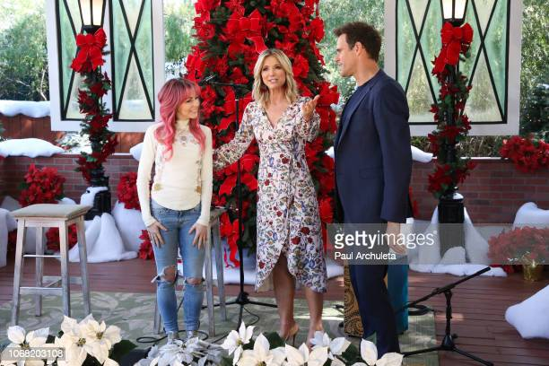 Lindsay Stirling Debbie Matenopoulos and Cameron Mathison on the set of Hallmark's 'Home Family' at Universal Studios Hollywood on November 15 2018...