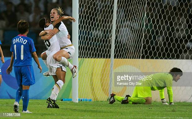 Lindsay Tarpley of the United States right leaps into the arms of teammate Angela Hucles to celebrate Hucles goal against Japan on Monday August 18...