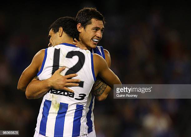 Lindsay Thomas and Aaron Edwards of the Kangaroos celebrate a goal during the round three AFL match between the North Melbourne Kangaroos and the...