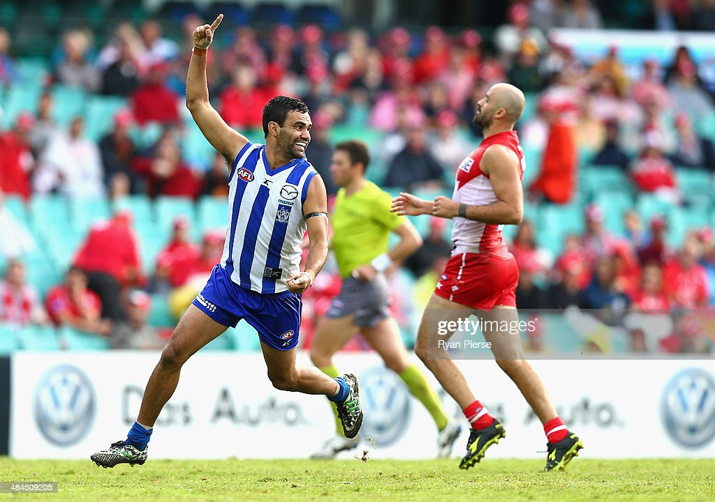 Lindsay Thomas of the Kangaroos celebrates a goal during the round four AFL match between the Sydney Swans and the North Melbourne Kangaroos at Sydney Cricket Ground on April 13, 2014 in Sydney, Australia.