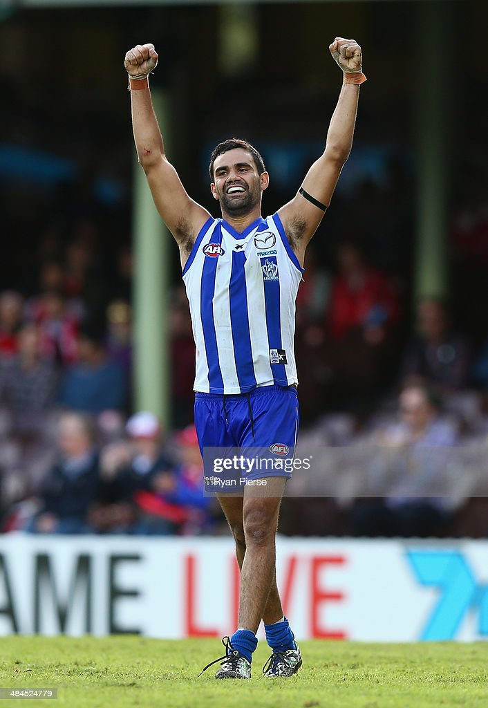 Lindsay Thomas of the Kangaroos celebrates victory during the round four AFL match between the Sydney Swans and the North Melbourne Kangaroos at Sydney Cricket Ground on April 13, 2014 in Sydney, Australia.