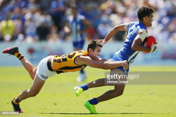 Lindsay Thomas of the Kangaroos is tackled by Liam Shiels of the Hawks during the JLT Community Series AFL match between the North Melbourne...