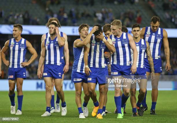 Lindsay Thomas of the Kangaroos leads his side from the field after losing the round four AFL match between the North Melbourne Kangaroos and the...