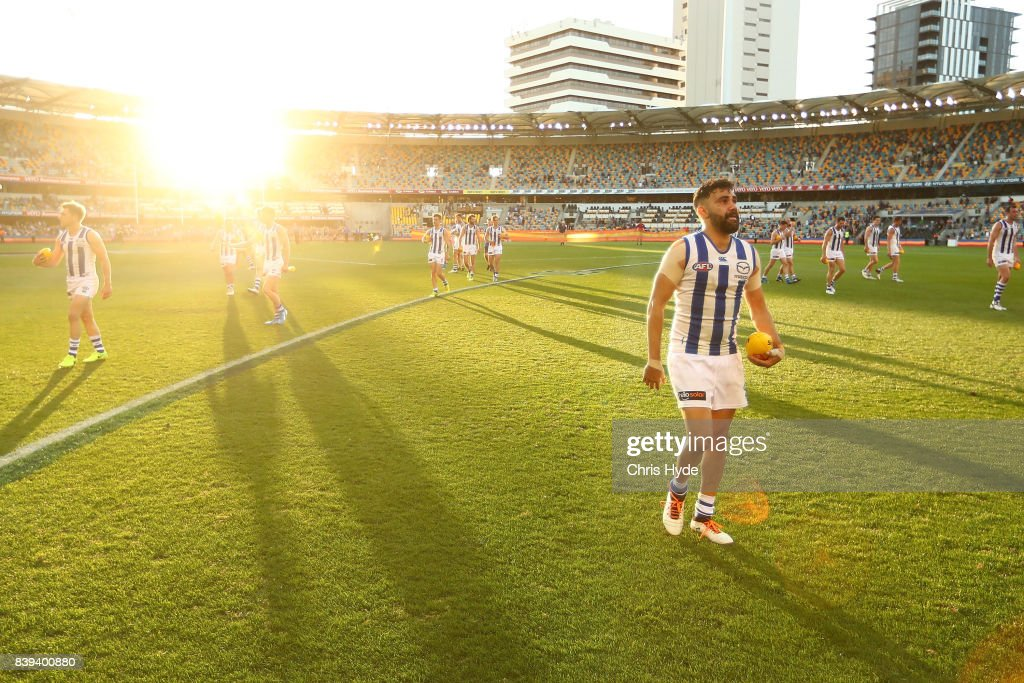 Lindsay Thomas of the Kangaroos leaves the field after winning the round 23 AFL match between the Brisbane Lions and the North Melbourne Kangaroos at The Gabba on August 26, 2017 in Brisbane, Australia.