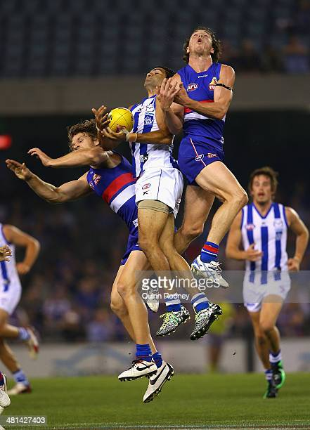 Lindsay Thomas of the Kangaroos marks infront of Liam Picken of the Bulldogs during the round two AFL match between the Western Bulldogs and the...