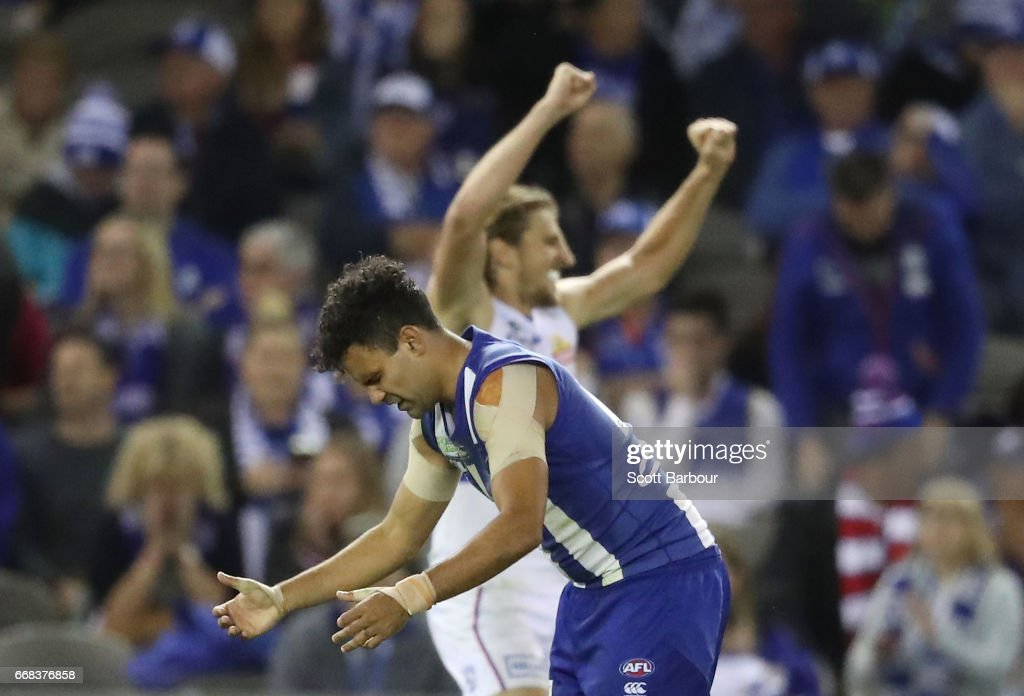 Lindsay Thomas of the Kangaroos reacts on the final siren as Marcus Bontempelli of the Bulldogs celebrates during the round four AFL match between the North Melbourne Kangaroos and the Western Bulldogs at Etihad Stadium on April 14, 2017 in Melbourne, Australia.