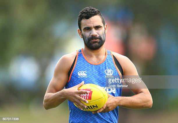 Lindsay Thomas of the Kangaroos runs with the ball during a North Melbourne Kangaroos AFL training session at Arden Street Ground on January 27 2016...