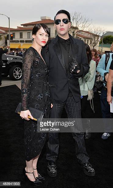Lindsay Usich and musician Marilyn Manson attend the premiere of Warner Bros Pictures and Alcon Entertainment's Transcendence at Regency Village...
