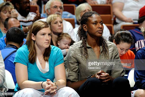 Lindsay Whalen and Asjha Jones of the Connecticut Sun watch the WNBA game against the Washington Mystics on September 13 2008 at the Mohegan Sun...
