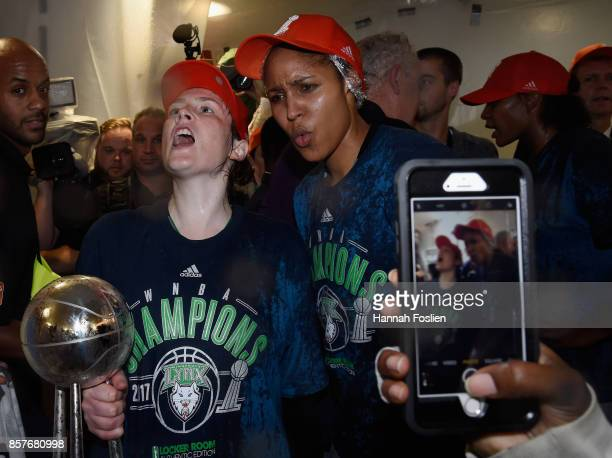 Lindsay Whalen and Maya Moore of the Minnesota Lynx celebrate winning against the Los Angeles Sparks in Game Five of the WNBA Finals on October 4...