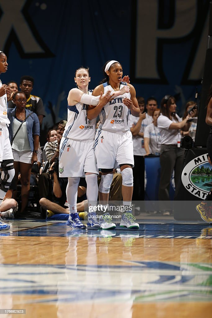 Lindsay Whalen #13 and Maya Moore #23 of the Minnesota Lynx react to the play against the Tulsa Shock during the WNBA game on August 16, 2013 at Target Center in Minneapolis, Minnesota.