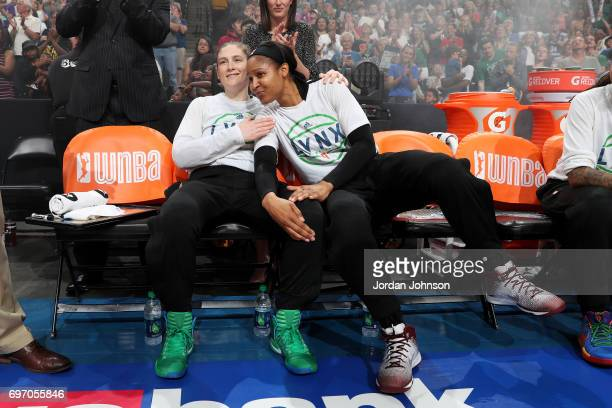 Lindsay Whalen and Maya Moore of the Minnesota Lynx wait for their starting line up introduction before the game against the Connecticut Sun during a...