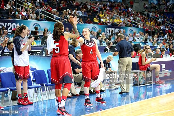 Lindsay Whalen and Seimone Augustus of the Women's Senior US National Team celebrate against Spain during the finals of the 2014 FIBA World...
