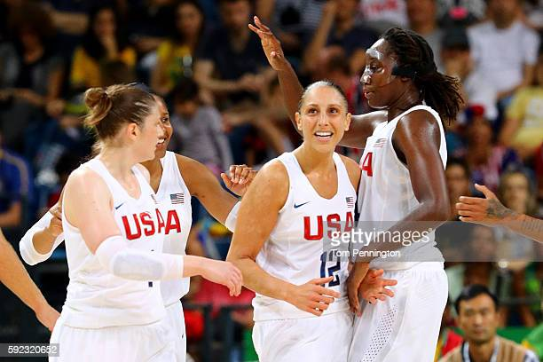 Lindsay Whalen Diana Taurasi Tina Charles of United States celebrate a play during the Women's Gold Medal Game between United States and Spain on Day...