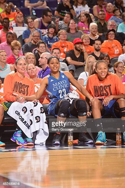 Lindsay Whalen Maya Moore and Seimone Augustus of the Western Conference AllStars sit on the bench during the 2014 Boost Mobile WNBA AllStar Game on...